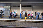 Passengers waiting on Highbury & Islington train station platform London