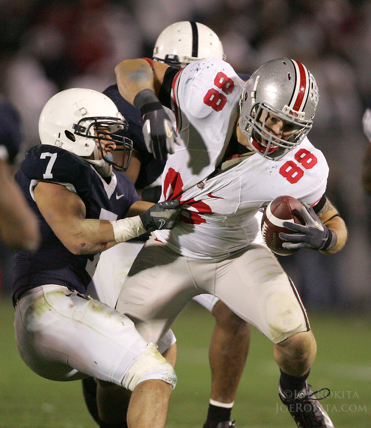 State College, PA -- 10/27/2007 -- Ohio State tight end Rory Nicol leans to gain extra yardage while Penn State safety Anthony Scirrotto attempts to bring him down.  Nicol had 6 catches for 39 yards during the game.  Ohio State defeated Penn State by a score of 37-17 on Saturday, October 27, 2007, at Beaver Stadium...Photo:  Joe Rokita / JoeRokita.com