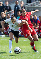 02 June 2013: U.S. National Women's Team player Carli Lloyd #10 battles with Canadian Women's player Rhian Wilkinson #7during an international friendly soccer match between the U.S Women's National Team and the Canadian Women's National Team at BMO Field in Toronto, Ontario Canada.