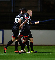 Lincoln City's Anthony Scully, right, celebrates scoring his side's second goal with team-mates Sean Roughan, left, and Timothy Eyoma<br /> <br /> Photographer Andrew Vaughan/CameraSport<br /> <br /> EFL Trophy Northern Section Group E - Mansfield Town v Lincoln City - Tuesday 6th October 2020 - Field Mill - Mansfield  <br />  <br /> World Copyright © 2020 CameraSport. All rights reserved. 43 Linden Ave. Countesthorpe. Leicester. England. LE8 5PG - Tel: +44 (0) 116 277 4147 - admin@camerasport.com - www.camerasport.com