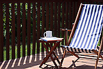 A relaxing summer morning tea and book on the deck