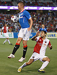 Kenny Miller towering over his man
