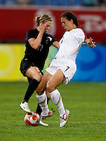 USWNT midfielder (7) Shannon Boxx collides with  New Zealand midfielder (11) Kirsty Yallop while playing at Wulihe Stadium.  The USWNT defeated New Zealand, 4-0, during the 2008 Beijing Olympics in Shenyang, China.  With the win, the USWNT won group G and advanced to the semifinals.