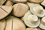 Hats await a customer in a market in Lombok, . Indonesia