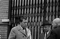 """Tournage du film """"La Bourse ou la Vie"""" de Jean Pierre Mocky, dans le quartier de St Sernin, Tououse, France, novembre 1965<br /> <br />  2 novembre 1965. L'acteur Fernandel et l'acteur Heinz Ruhmann lors du tournage<br /> <br /> <br /> PHOTO:  Fonds André Cros,"""