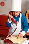 Preschool 4-5 year olds pretend play girl taking order on phone for restaurant vertical