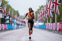 4th October 2020, London, England; 2020 London Marathon; Brigid Kosgei (KEN) runs along The mall during the Elite Women's Race. The historic elite-only Virgin Money London Marathon taking place on a closed-loop circuit around St James's Park in central London on Sunday 4 October 2020.