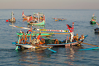 Jimbaran, Bali, Indonesia.  Fishing Boat Heading out to Sea in the Early Morning.
