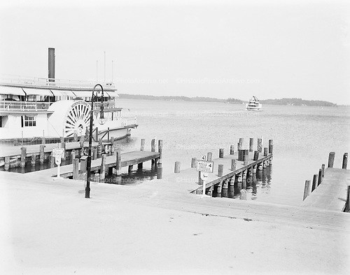 "0012-2 Ferry dock on Lake Minnetonka, near Minneapolis, Minnesota. The ""Minnetonka"" is taking on passengers for Tonka Bay, Wheeler's Big Island, Minnetonka Beach, Lafayette Club, Arcola. ca. 1906."