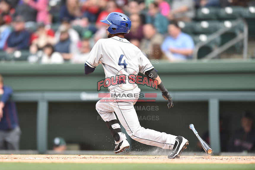 Asheville Tourists shortstop Carlos Herrera (4) swings at a pitch during a game against the  Greenville Drive at Fluor Field on April 10, 2016 in Greenville South Carolina. The Drive defeated the Tourists 7-4. (Tony Farlow/Four Seam Images)