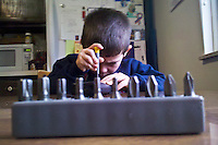 Young boy plays with his tool kit received as a Christmas gift. From Verizon Droid camera.