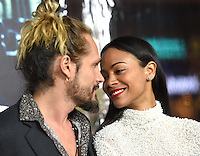 Zoe Saldana + husband Marco Perego @ the premiere of 'Live By Night' held @ the Chinese theatre. January 9, 2017