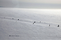 Eric Rogers runs along the Bering Sea coast near Moses Point between Koyuk and Ellim on Friday afternoon.