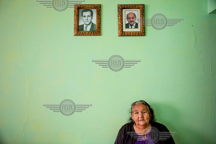 A Roma woman, originally from the city of Liberec in the Czech Republic, sits in her apartment beneath portraits of her husband and son, both dead. She lives in Stara Tehelna. This suburb is a segregated district populated by Roma who were moved en mass out of the city centre in 2001....