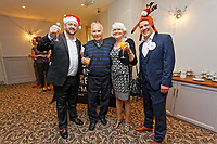 Pictured: Lottery winners Nigel Willett (L) and Matt Evans (R) welcome guests as they arrive. Wednesday 28 November 2018<br /> Re: National Lottery millionaires from south Wales and the south west of England have hosted a glitzy Rat Pack-inspired Christmas party for an older people's music group at The Bear Hotel in Cowbridge, Wales, UK.
