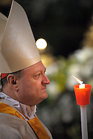 Cardinal Gianfranco Ravasi;Pope Francis, holds a candle during the Easter vigil mass in Saint Peter's Basilica, in the Vatican.,30 March 2013