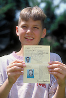 Young boy with Iroquois passport he uses when he travels outside the USA.