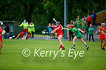 Kerry's Elaine Ryall attempts to block the effort of Corks Aoife Twohill  in the Munster Junior Camogie semi final.