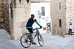 A man rides a bike during the first day of liftning of the confinement restrictions in Caceres, Extremadura. 02 May 2020(Alterphotos/Francis Gonzalez)