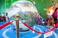 China. Shanghai. World Expo. Expo 2010 Shanghai China.  China Pavilion. A  globe with a chinese landscape and templs in the Fujian pavilion. Signs: Exit and Don't touch. Red rope. 25.06.10 © 2010 Didier Ruef