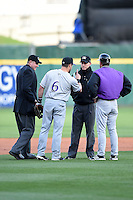 Louisville Bats outfielder Skip Schumaker (6) makes his point with third base umpire Brian De Brauwere as home plate umpire Chad Whitson and manager Jim Riggleman listen in during a game against the Buffalo Bisons on April 29, 2014 at Coca-Cola Field in Buffalo, New  York.  Buffalo defeated Louisville 4-1.  (Mike Janes/Four Seam Images)
