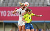 TOKYO, JAPAN - JULY 20: Lindsey Horan #9 of the United States and Kosovare Asllani #9 of Sweden battle for a ball in the air during a game between Sweden and USWNT at Tokyo Stadium on July 20, 2021 in Tokyo, Japan.