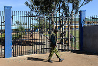 TANZANIA Mara, Tarime, village Masanga, region of the Kuria tribe who practise FGM Female Genital Mutilation, temporary rescue camp of the Diocese Musoma for girls which escaped from their villages to prevent FGM, armed police secure the camp / TANSANIA Mara, Tarime, Dorf Masanga, in der Region lebt der Kuria Tribe, der FGM weibliche Genitalbeschneidung praktiziert, temporaerer Zufluchtsort fuer Maedchen, denen in ihrem Dorf Genitalverstuemmelung droht, in einer Schule der Dioezese Musoma, bewaffnete Polizisten schuetzen das Camp