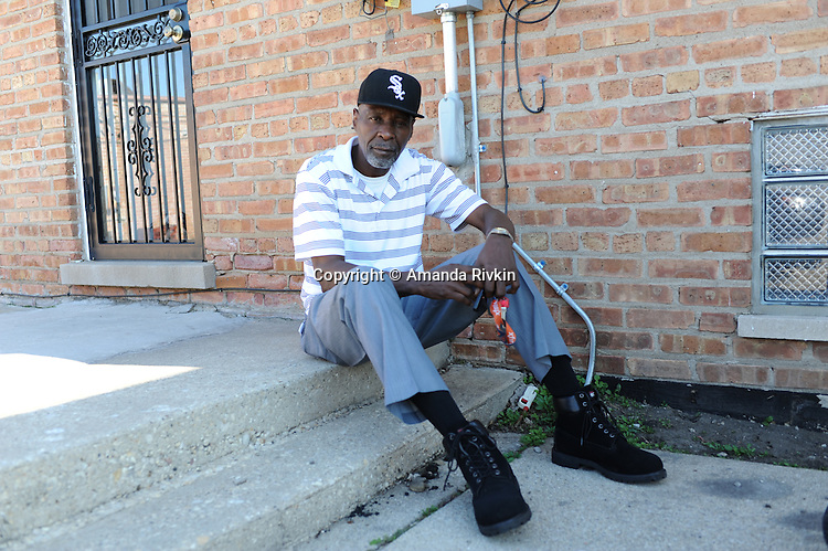 Stanley Wrice sits ion the back stoop of the home he shares with his daughter and son-in-law in Calumet City, Illinois on November 4, 2015.  Wrice spent 31 years in jail for a crime he did not commit after a confession was extracted from him in 1982 by Chicago Police Area Two detectives using methods classified as torture.
