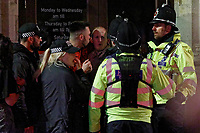 Pictured: Two men are spoken to by police officers in Wind Street, Swansea, Wales, UK. Friday 20 December 2019<br /> Re: Black Eye Friday (also known as Black Friday, Mad Friday, Frantic Friday) the last Friday before Christmas, in Swansea, Wales, UK.