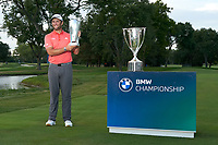 30th August 2020, Olympia Fields, Illinois, USA; Jon Rahm of Spain celebrates with the J.D. Wadley trophy and the BMW trophy after winning on the first sudden-death playoff hole against Dustin Johnson (not pictured) during the final round of the BMW Championship on the North Course at Olympia Fields Country Club