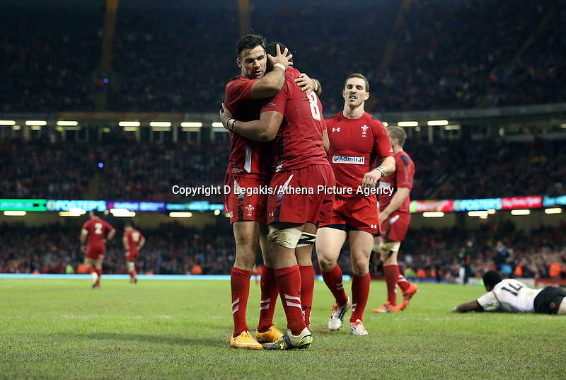 Pictured: Taulupe Faletau (C) celebrating his try for Wales with team mates Mike Phillips (L) and George North (R). Saturday 15 November 2014<br /> Re: Dove Men Series rugby, Wales v Fiji at the Millennium Stadium, Cardiff, south Wales, UK.