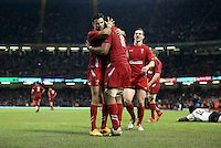 Pictured: Taulupe Faletau (C) celebrating his try for Wales with team mates Mike Phillips (L) and George North (R). Saturday 15 November 2014<br />