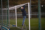 The groundsman inspecting the goal nets before Cambrian and Clydach Vale take on Cwmbran Celtic at King George's New Field in a Welsh League Division One match, the top division of the Welsh Football League and the second level of the Welsh football league system. The club, formed in 1965 reached the final of the 2018-19 League Cup final and can count on ex-England manager Terry Venables as a former club chairman. Cambrian and Clydach Vale won this match 2-0, watch by a crowd of around 100 spectators.
