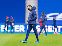 LE HAVRE, FRANCE - APRIL 13: Vlatko Andonovski of the USWNT walks on the field before a game between France and USWNT at Stade Oceane on April 13, 2021 in Le Havre, France.