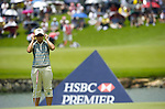 SINGAPORE - MARCH 08:  Eun-Hee Ji of South Korea adjust her sunglasses on the par tree 11th hole during the final round of HSBC Women's Champions at the Tanah Merah Country Club on March 8, 2009 in Singapore. Photo by Victor Fraile / The Power of Sport Images