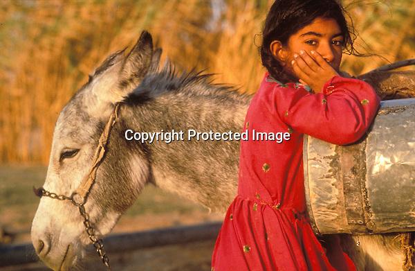 Syria, ..Donkey and girl...Photo Kees Metselaar