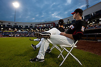 A member of the Western All Stars sits and watches the second round participants during the Midwest League All-Star Home Run Derby at Modern Woodmen Park on June 20, 2011 in Davenport, Iowa. (David Welker / Four Seam Images)