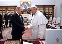 Pope Francis receives Russian President Vladimir Putin during a private audience at the Vatican, on November 25, 2013.