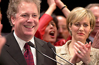 April 14, 2003, Montreal, Quebec, Canada<br /> <br /> Jean Charest, Leader of  Quebec Liberal Party <br /> and Quebec new Premier and<br /> MichËle Dionne ,  his wife (R) adresses the Liberal  troops in Montreal on the  provincial election night,<br /> <br /> the election results are<br />  45,4 % of the vote for his Jean Charest's Liberal party,<br /> 33,4 % of the vote for Bernard Landry's Parti Quebecois and<br /> 18,6 % of the votes for Mario Dumont's Action Democratique du Quebec<br /> <br /> <br /> Mandatory Credit: Photo by Pierre Roussel- Images Distribution. (©) Copyright 2003 by Pierre Roussel