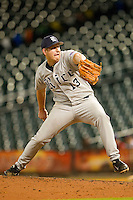 Relief pitcher John Simms #13 of the Rice Owls in action against the Tennessee Volunteers at Minute Maid Park on March 4, 2012 in Houston, Texas.  The Owls defeated the Volunteers 11-1.  Brian Westerholt / Four Seam Images