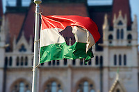 Flag with a hole in it  commemorating the 1956 uprising outside Parliament, Budapest, Hungary