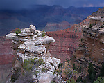 Grand Canyon National Park, AZ   <br /> Approaching storm clouds over the Grand canyon and rock outcrop near Mather Point