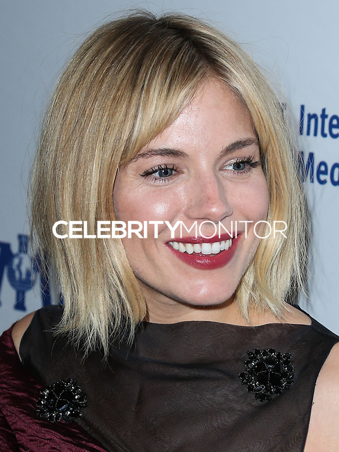 BEVERLY HILLS, CA, USA - OCTOBER 23: Sienna Miller arrives at the 2014 International Medical Corps' Annual Awards Dinner Ceremony held at the Beverly Wilshire Four Seasons Hotel on October 23, 2014 in Beverly Hills, California, United States. (Photo by Xavier Collin/Celebrity Monitor)