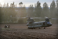 A  Dutch Chinook helicopter take on a casualty from air mobile troops during NATO exercise Noble Ledger in Norway. The NATO Response Force (NRF) is a multinational force made up of land, air, maritime and Special Operations Forces components. The exercise includes around 6500 soldiers from the USA, Germany, Netherlands, Denmark, Belgium and Norway. Photo: Fredrik Naumann/Panos Pictures