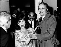 Montreal (Qc) CANADA - Oct 1985 File Photo - gina Lollobrigida (L), Serge Losique (R) at Italian week, The Bay store<br /> <br /> PHOTO :  Agence Quebec Presse