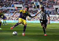 Pictured L-R: Angel Rangel of Swansea against Mathieu Debuchy of Newcastle. Saturday 19 April 2014<br /> Re: Barclay's Premier League, Newcastle United v Swansea City FC at St James Park, Newcastle, UK.