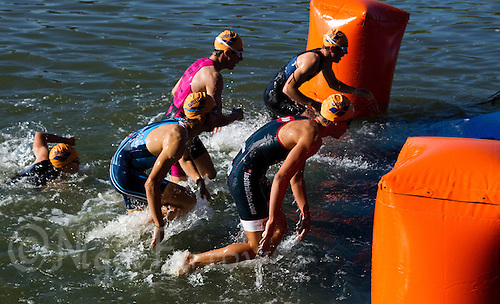 27 MAY 2012 - MADRID, ESP - Competitors leave the water at the end of the swim during the Spanish Junior Men's National Series Sprint Distance race at Casa de Campo in Madrid, Spain .(PHOTO (C) 2012 NIGEL FARROW)