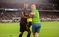 LOS ANGELES, CA - OCTOBER 29: Brad Smith #11 of Seattle Sounders FC and Mark-Anthony Kaye #14 of Los Angeles FC look back at flying beer containers during a game between Seattle Sounders FC and Los Angeles FC at Banc of California Stadium on October 29, 2019 in Los Angeles, California.