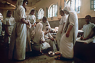 """Calcutta, India. April 04, 1975.<br /> Mother Teresa visits patients at her free hospice for the poor in Calcutta. The first Home for the Dying opened in 1952 and was a free hospice for the poor. Mother Teresa (Agnes Gonxha Boyaxihu) the Roman Catholic, Albanian nun revered as India's """"Saint of the Slums,"""" was awarded the 1979 Nobel Peace Prize."""
