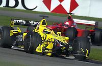 Jean Alesi (#12 Jordan) leads Michael Schumacher (#1 Ferrari)
